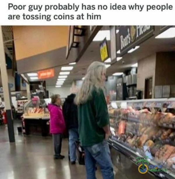 Poor guy probably has no idea why peoe are tossing coins at him